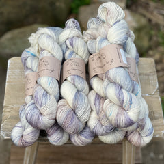 Variegated cream, blue and grey yarn