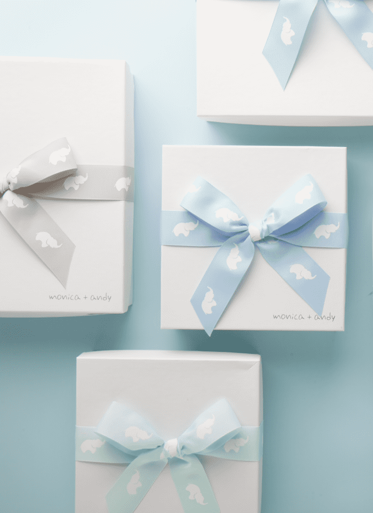 Monica and Andy gift boxes with printed bows