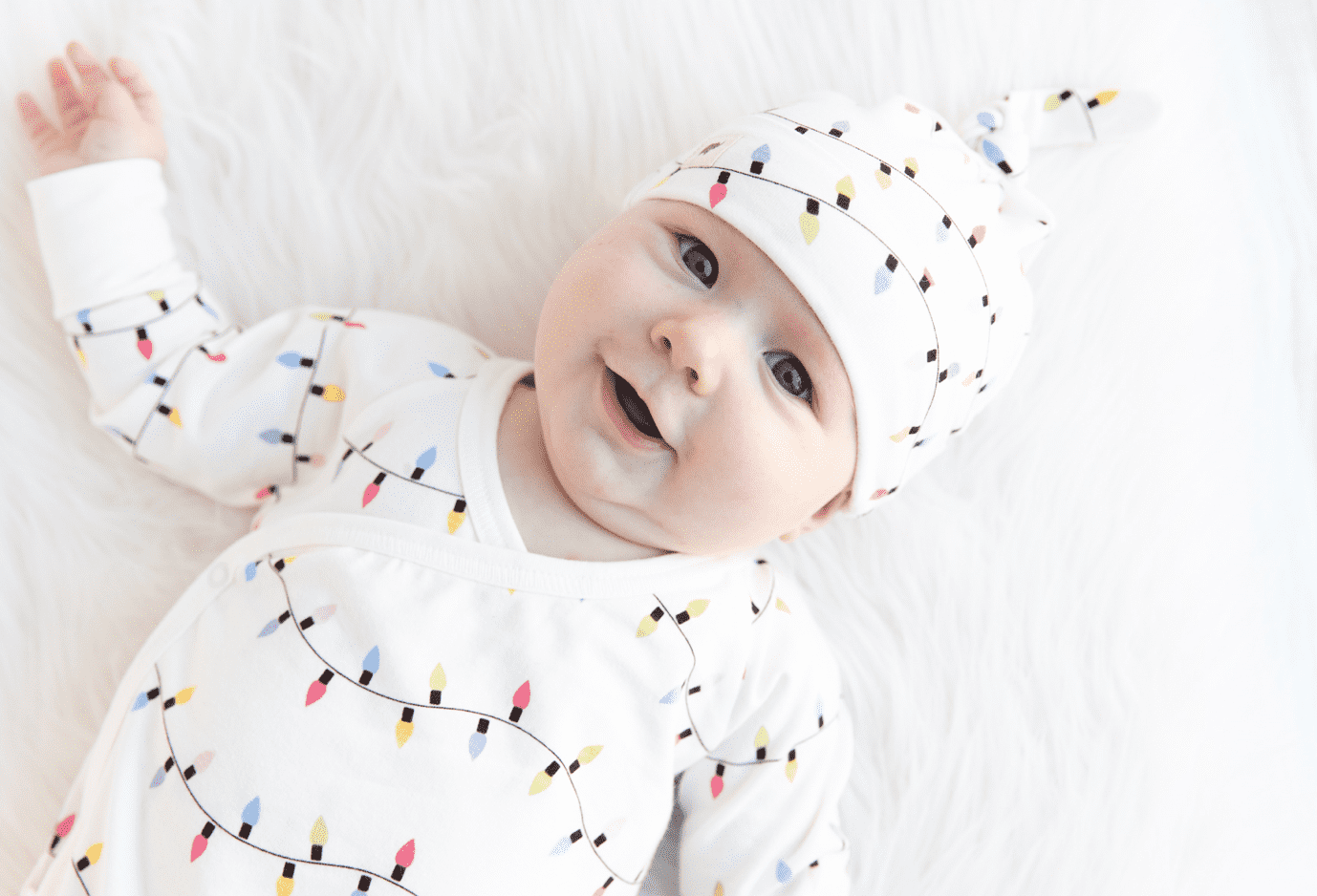 baby in holiday print romper and hat