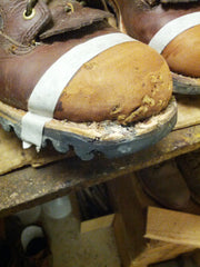 Prepping the hunting boot for a Tuff Toe Boot Repair.