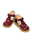 Burgundy Mary Jane girls shoe with heart detail and velcro strap made from 100% leather.