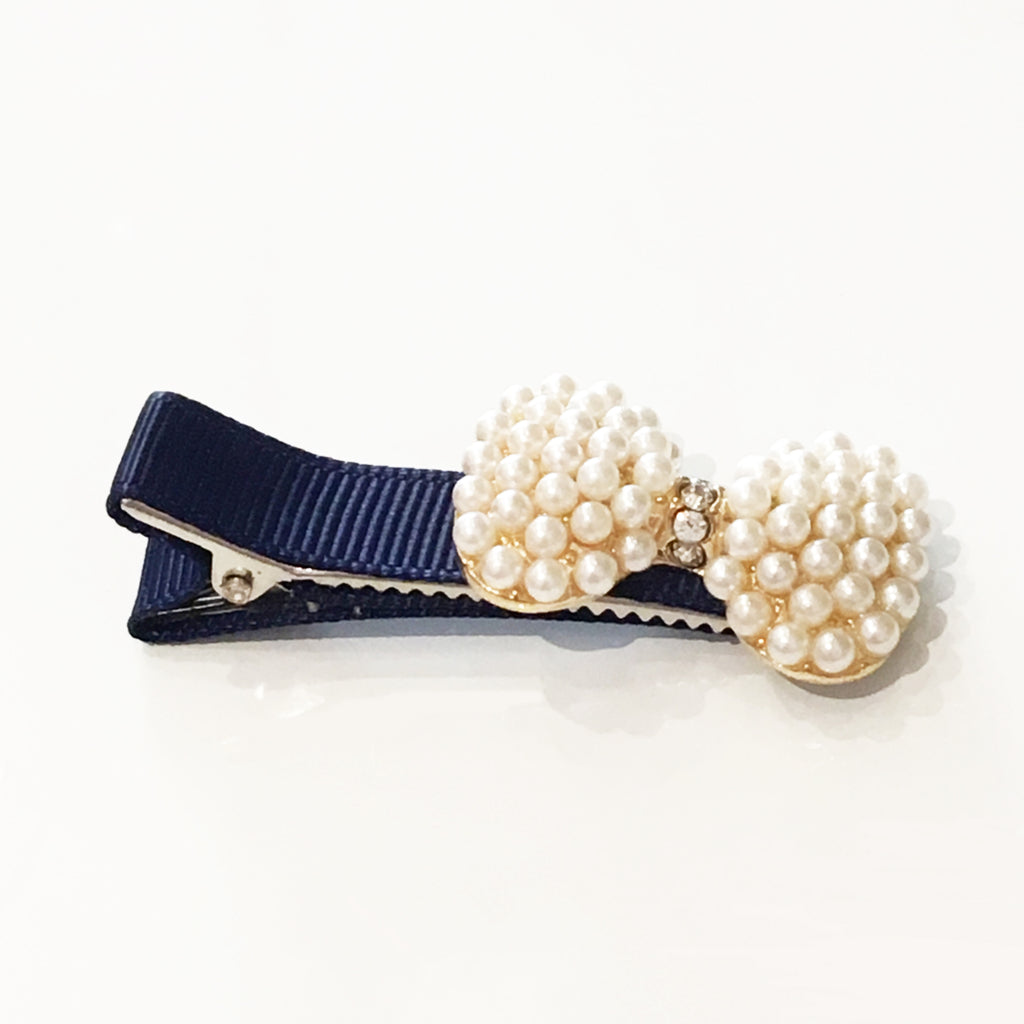 Navy Blue Pearl Bow Pinch Clips - Annie Apple ACCESSORIES Annie Apple at Kids Emporium by Lazy Francis - Shop in store at 406 Kings Road, Chelsea, London or shop online at www.kidsemporiumonline.com