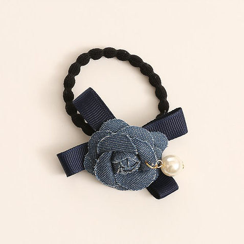 Dark Denim Flower, Bow & Pearl Hair Tie - Annie Apple ACCESSORIES Annie Apple at Kids Emporium by Lazy Francis - Shop in store at 406 Kings Road, Chelsea, London or shop online at www.kidsemporiumonline.com