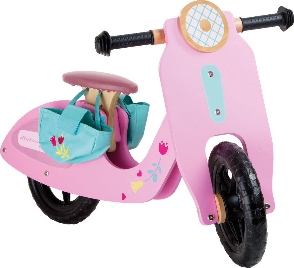 Pink Speedster Girls Walk Bike Toy Legler,Small Foot Company at Kids Emporium by Lazy Francis - Shop in store at 406 Kings Road, Chelsea, London or shop online at www.kidsemporiumonline.com