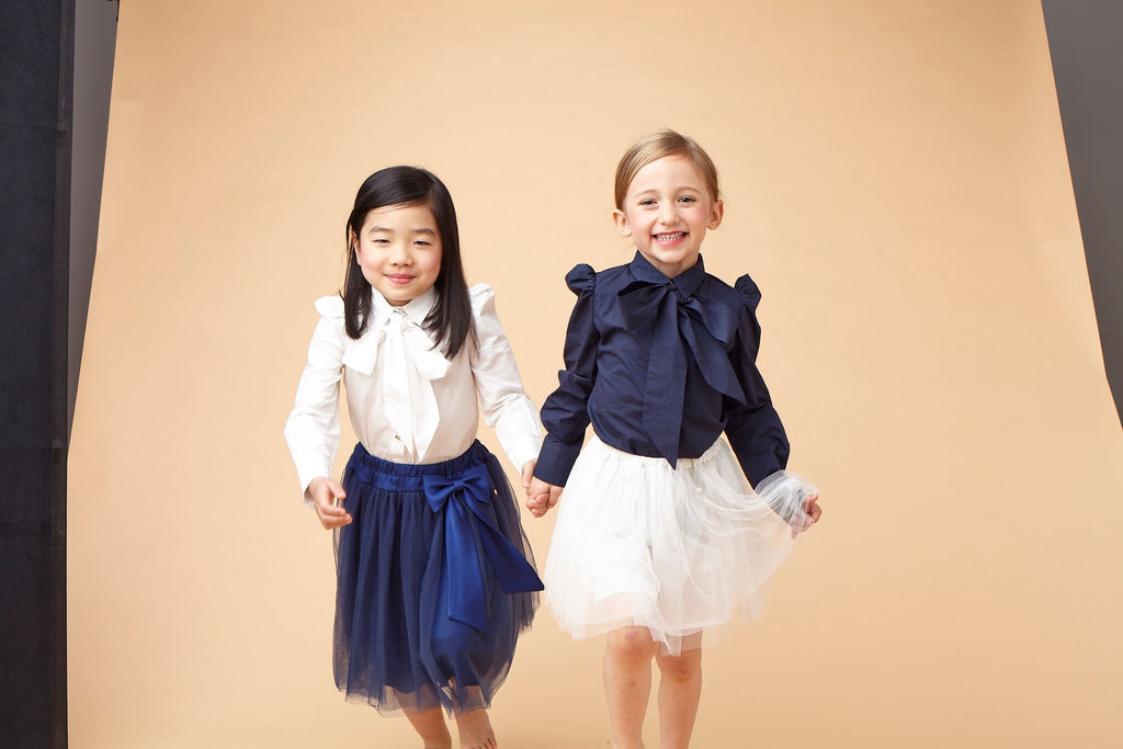 White Girls Blouse with a Bow Blouse Le Mu at Kids Emporium by Lazy Francis - Shop in store at 406 Kings Road, Chelsea, London or shop online at www.kidsemporiumonline.com