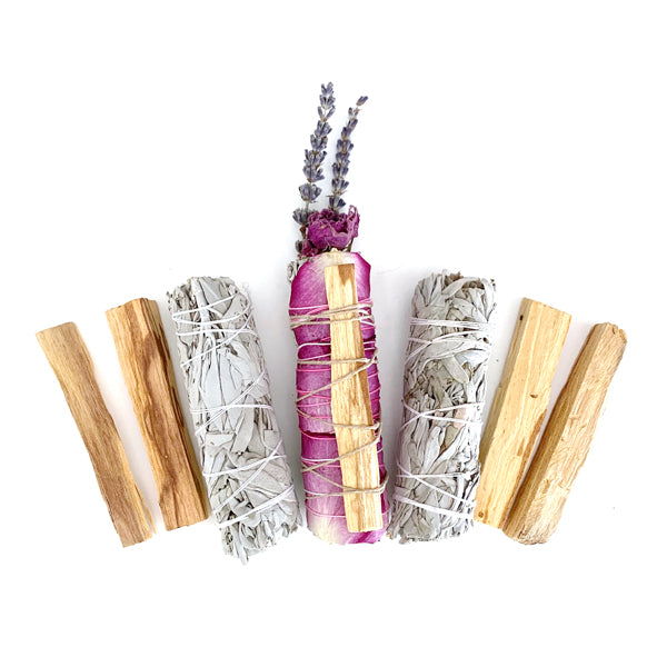 Four Palo Santo Sticks, Two White Sage Smudge Sticks, One Floral White Sage Smudge Stick.