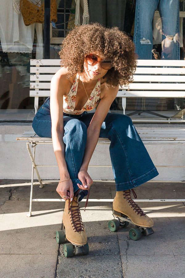 Spring Thing Shop The Canyon model putting on disco roller skates los angeles Shop The Vibe!