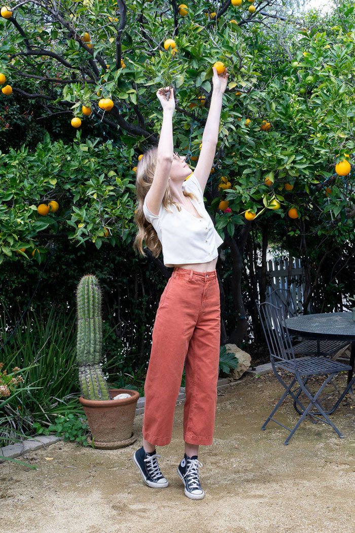 julia reaching for oranges shop the canyon