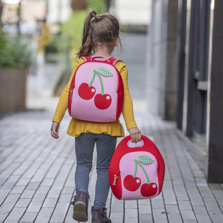 Girl walking home from school carrying Dabbawalla bags machine washable Cherry backpack and lunch bag.