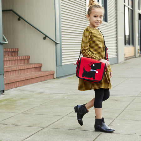 Back to school with girl wearing a Scotty Dog Kid's Messenger Bag.