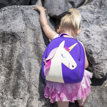 Active preschool girl wearing the Dabbawalla Bags Unicorn backpack Bag material is lightweight, washable and sustainable.