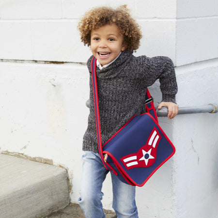 Boy wearing an American Vintage Flyer Messenger Bag  by Dabbawalla Bags.