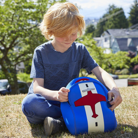 Boy using a roomy Dabbawalla lunch bag with an airplane theme.