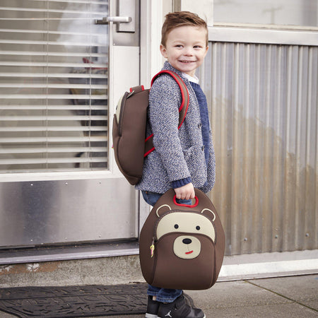 First day of school with a young boy holding a Dabbawalla Lunch Bag and a Dabbawalla Preschool Backpack.