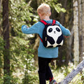 Young boy hiking in the woods with the Panda backpack.