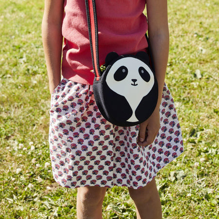 Close-up of Panda Cross-body bag.  Cute black and white panda face . Contrast binding on the adjustable strap.