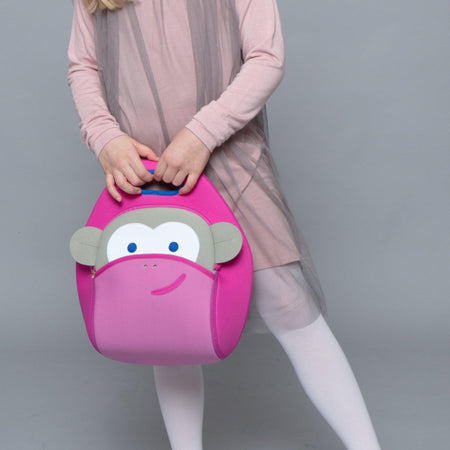 Young girl with pink dress holding the  cute Dabbawalla pink monkey lunchbox.