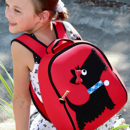 Elementary school girl wearing the Scotty Dog Backpack by Dabbawalla Bags.