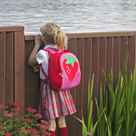 Student wearing  cute strawberry backpack from Dabbawalla bags