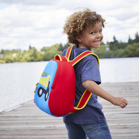 Preschool boy with a big smile wearing the Dabbawalla Bags truck theme backpack.