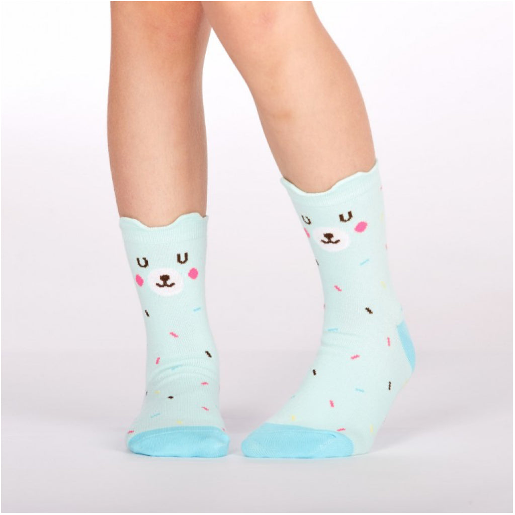 Kid weaering cute bear socks.