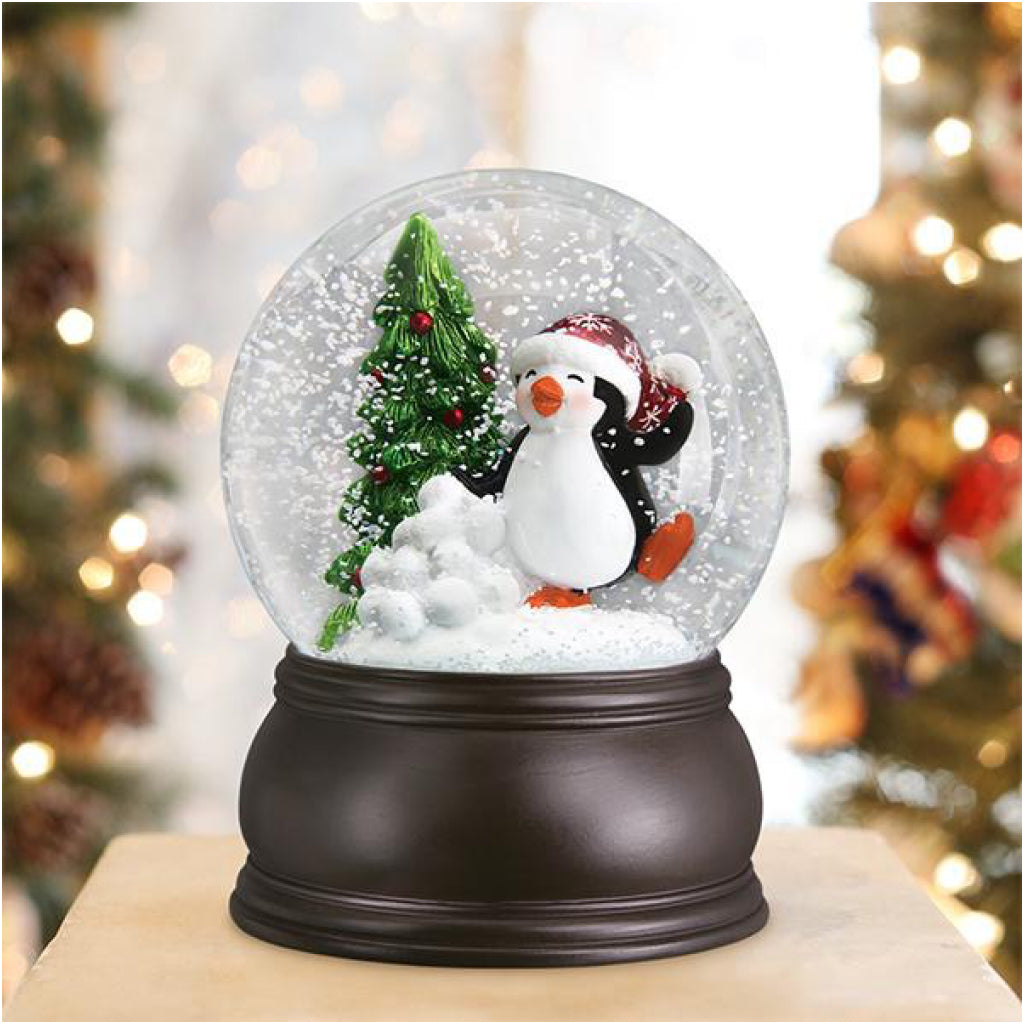 Lifestyle shot of Dancing Penguin Snow Globe.
