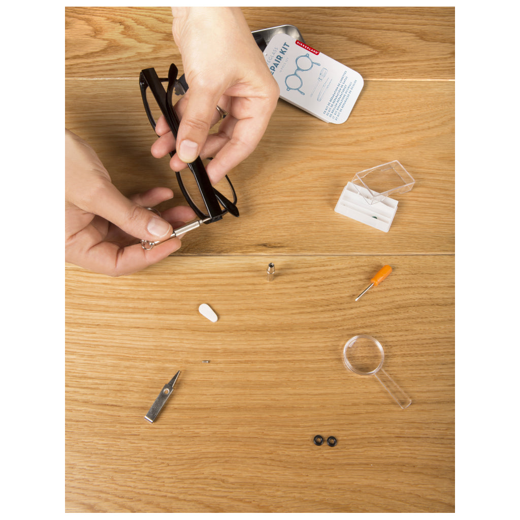 Fixing glasses with Eyeglass Repair Kit.