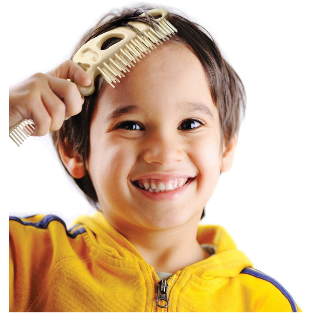 Child using Bonehead Folding Comb.