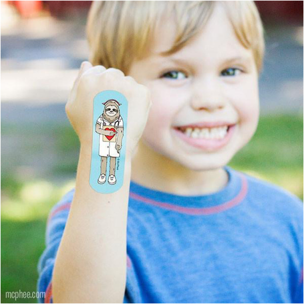 Kid wearing Sloth Bandaid