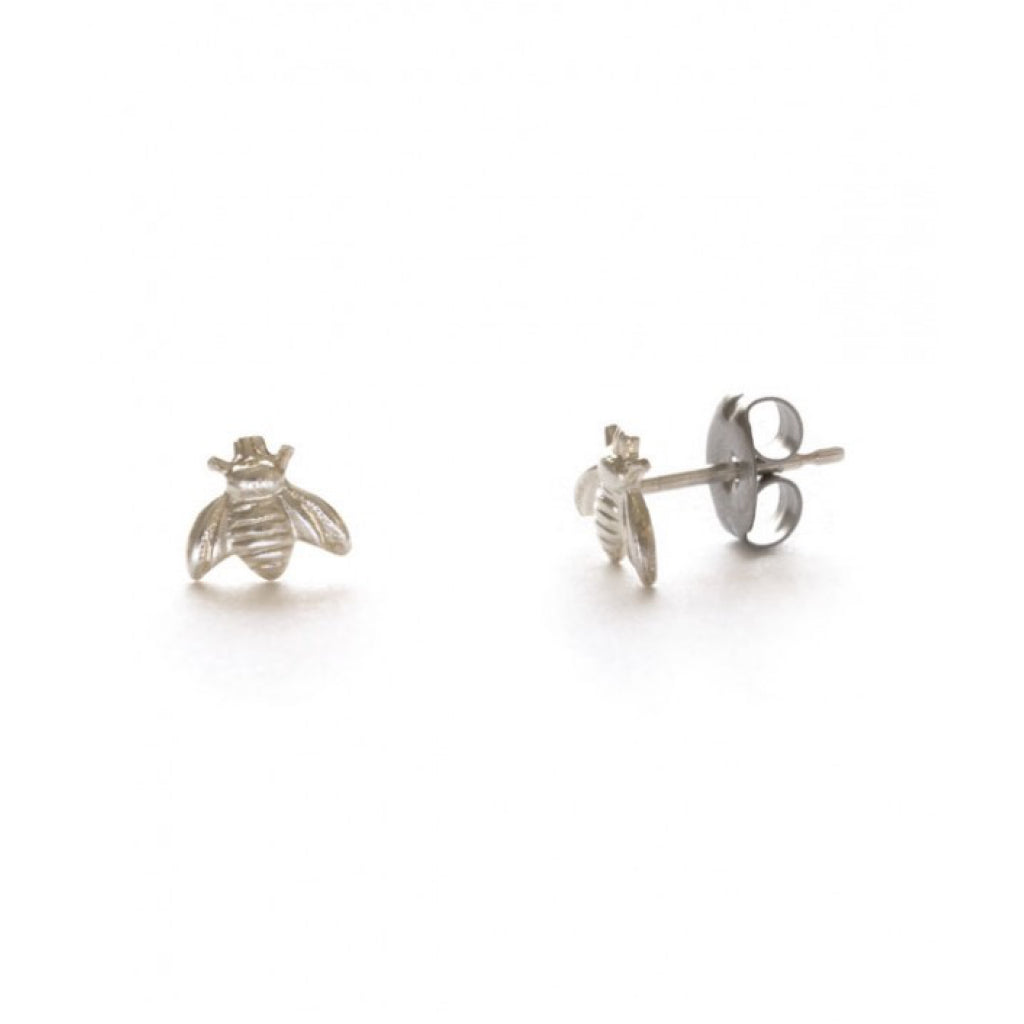 Closeup of Tiny Bee Silver Studs.