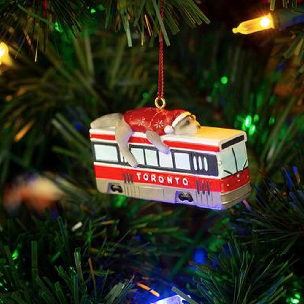 Lifestyle image of Toronto Raccoon Streetcar Ornament.