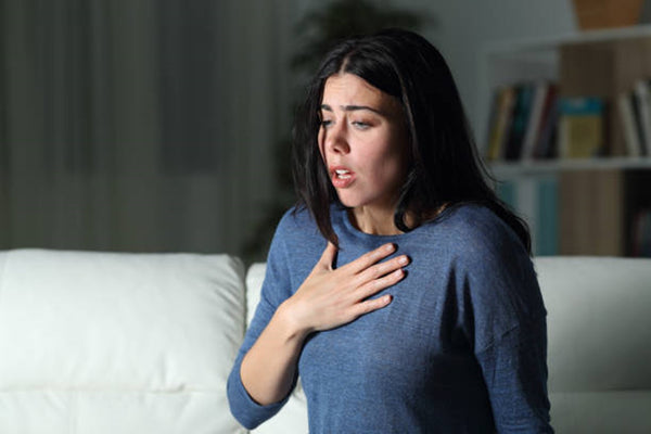 Woman suffering an anxiety attack alone in the night Woman suffering an anxiety attack alone in the night choking stock pictures, royalty-free photos & images