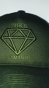 Duke Diamante Green Trucker Hat