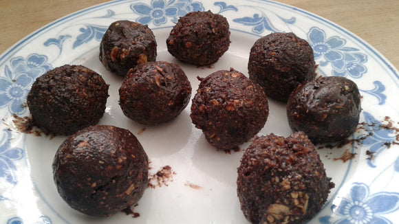 The finished product. Nine delicious, healthy Maple-Pecan Duet energy balls.
