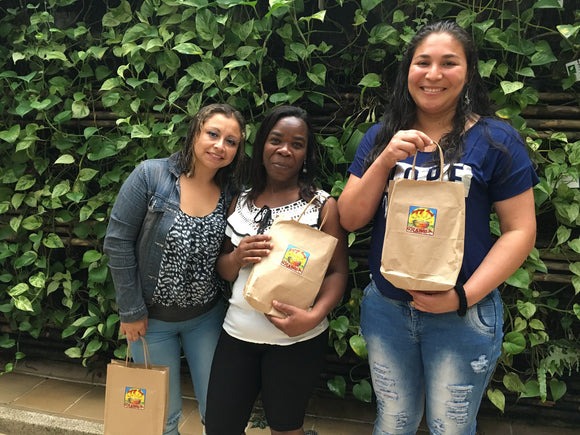 3 Colombian women receiving the profit-share from Singing Bowl Granola