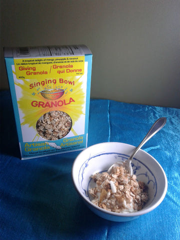 A bowl and box of Giving Granola