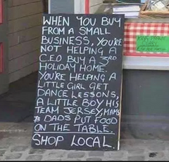Sign explaining why you should shop local