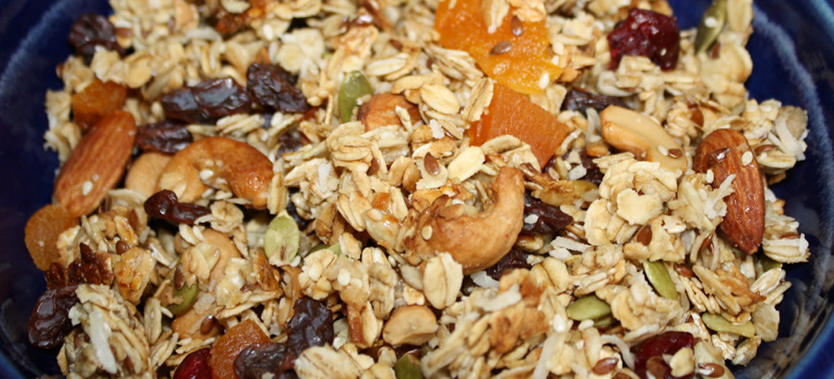 A bowl of healthy looking fruit and nut artisan granola