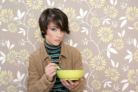 Gender non-defined person eating granola