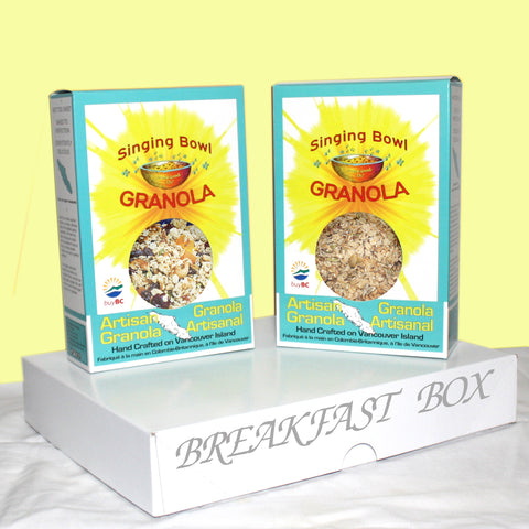 two bags of artisan granola and a bag of sepialty organic porridge