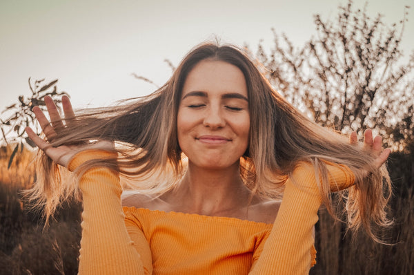 Autoimmune Diet: A happy woman plays with her hair