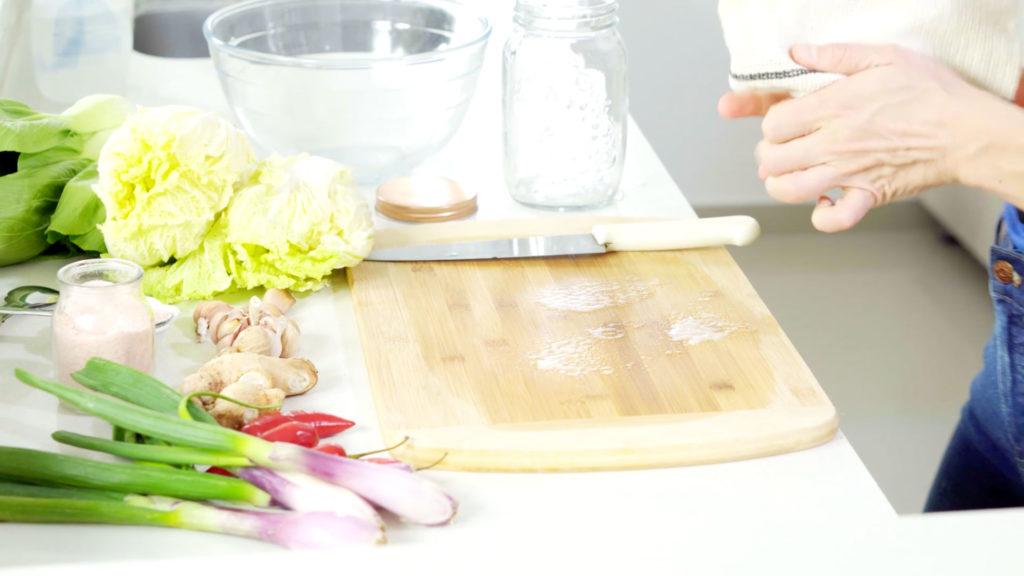 vegetables by a cutting board