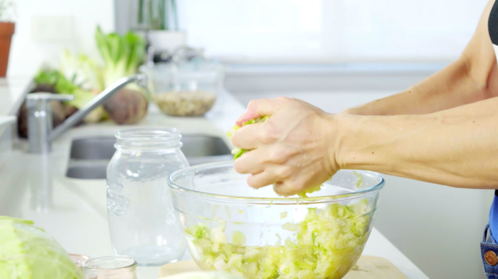 squeezing cabbage in a bowl