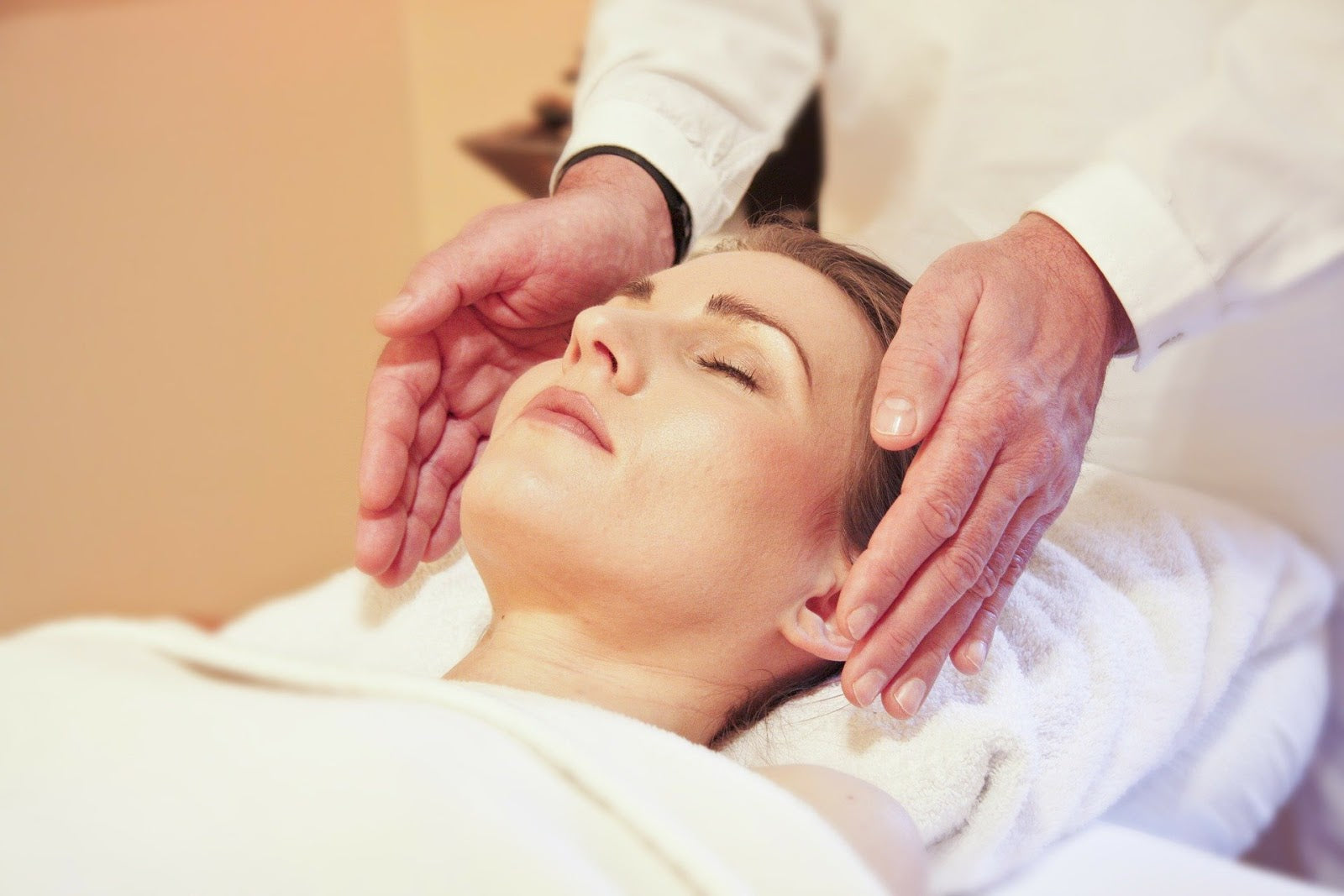 How to get rid of bloating: A woman relaxes before a massage