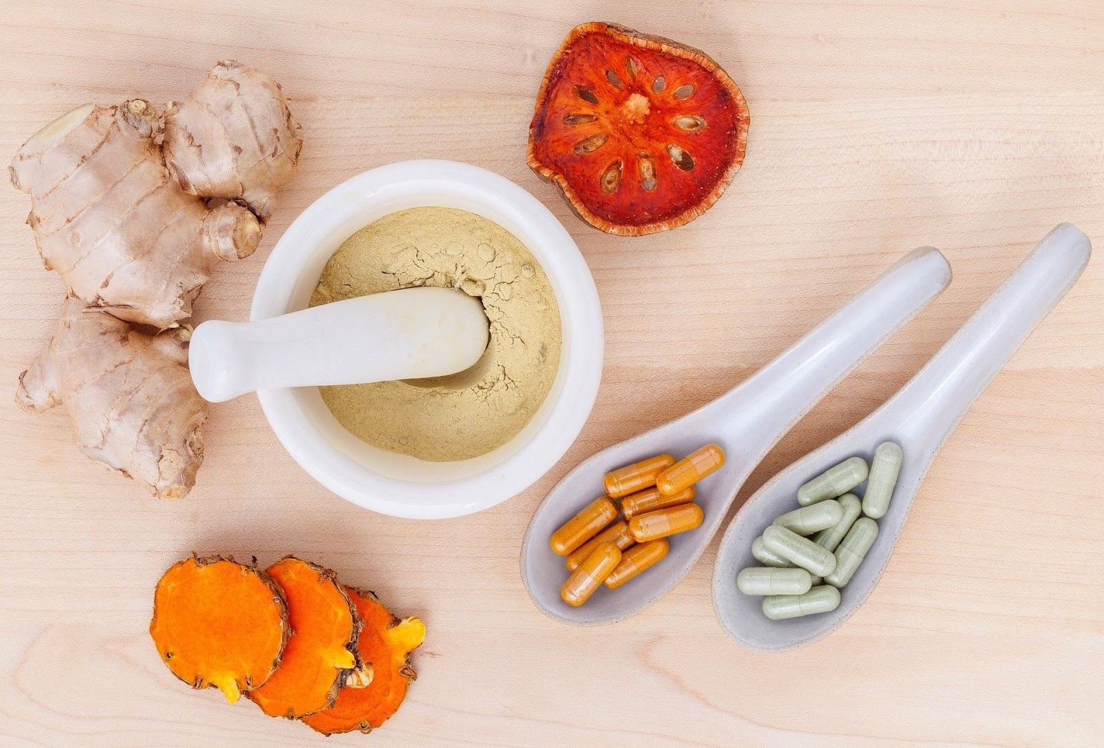Supplements for inflammation: herbs in a mortar and pestle