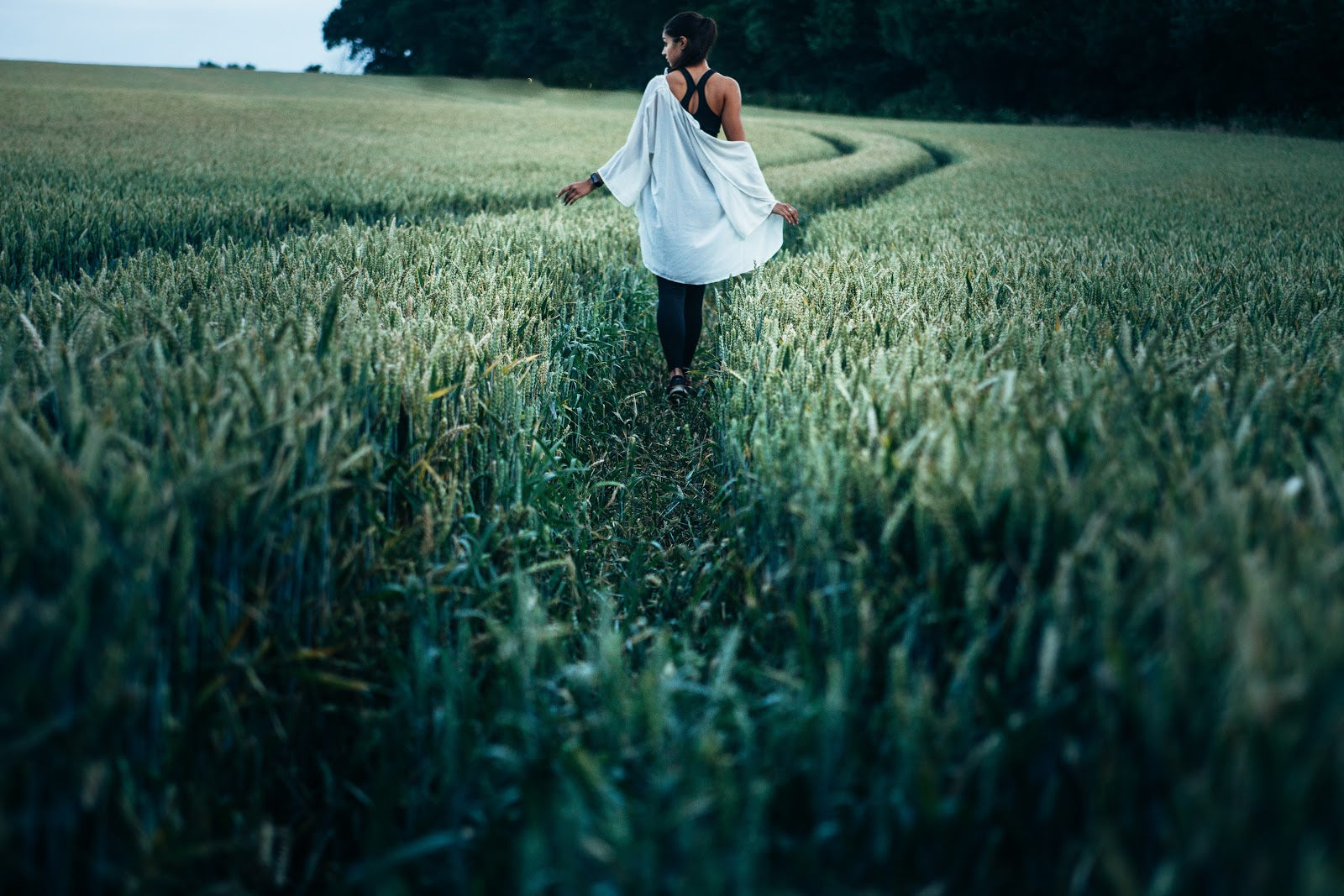 Gut dysbiosis: A woman walks through a field