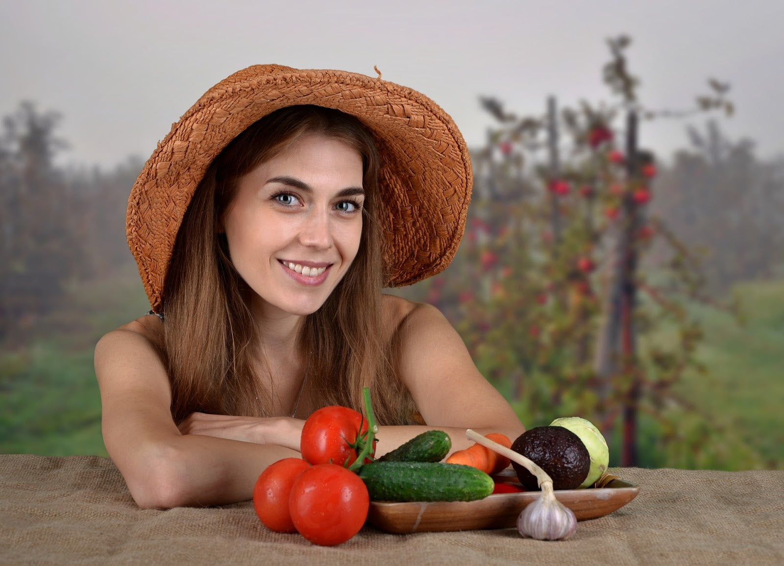 How to balance hormones: Girl in a farmer's hat with vegetables