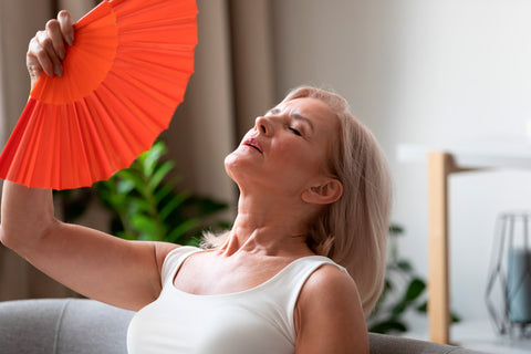 woman fanning her self to cool down