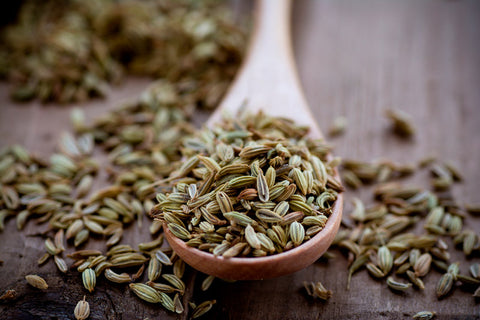 fennel seed on a wood spoon