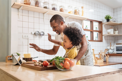 Girl and Dad Cooking Together in the kitchen
